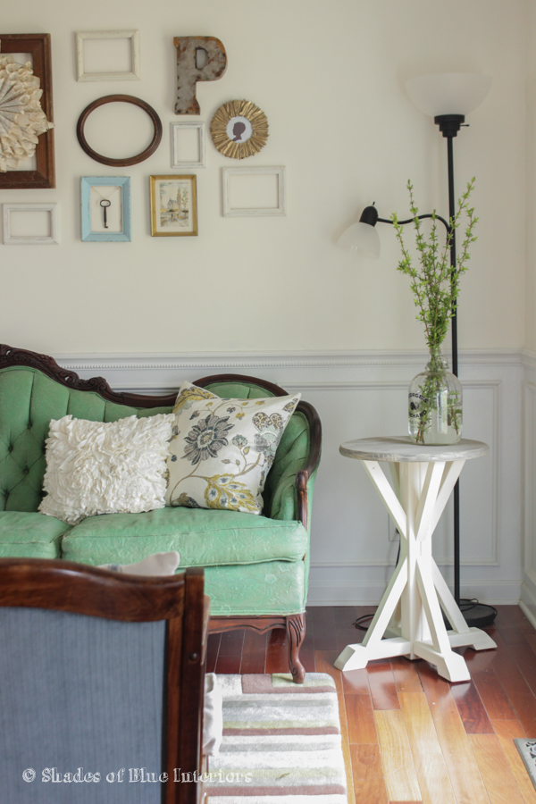 Love this eclectic gallery wall and the gorgeous vintage green sofa kellyelko.com