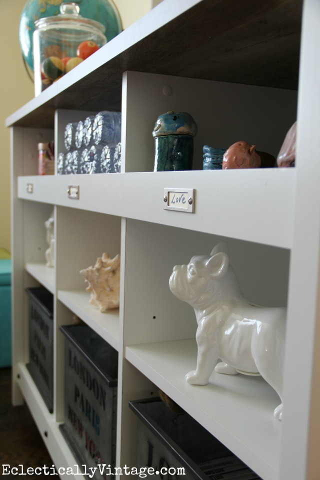Love this storage console - the cubbies are perfect for display kellyelko.com