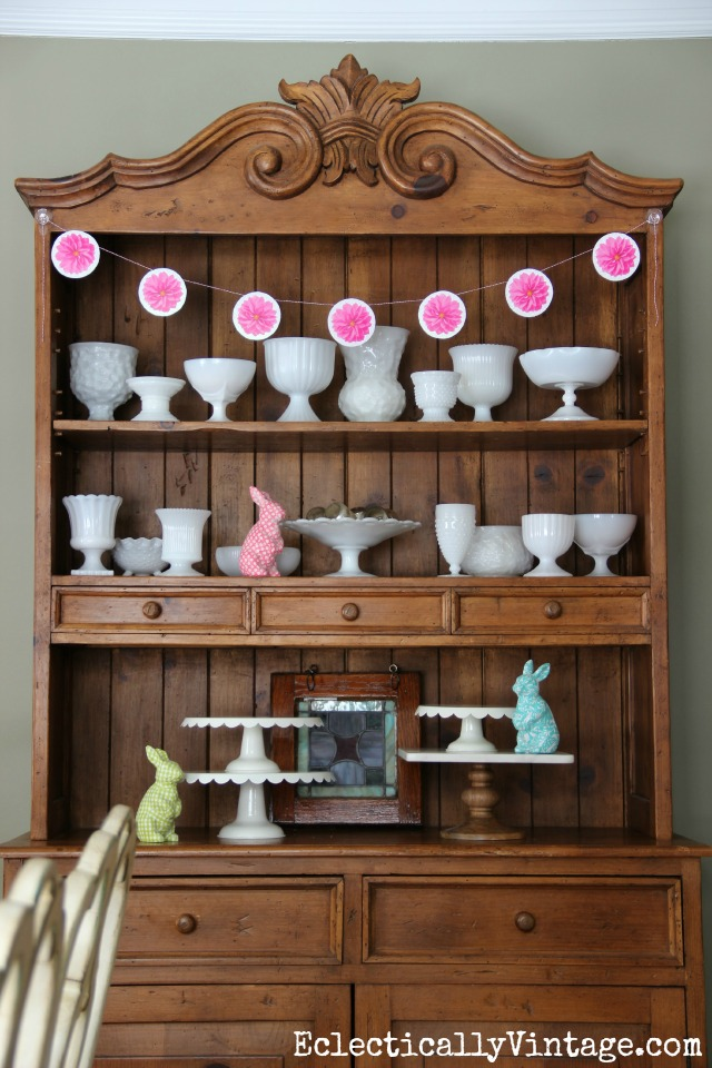 Love this dining room hutch filled with vintage milk glass kellyelko.com