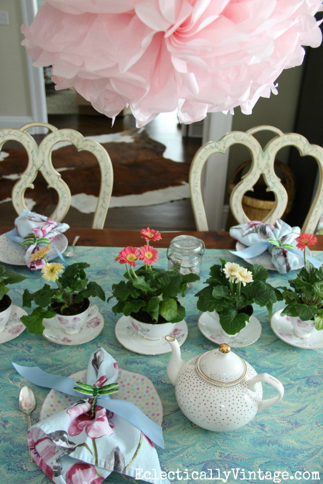 See how to set a fun spring table - this dining room was transformed for a festive tea party kellyelko.com