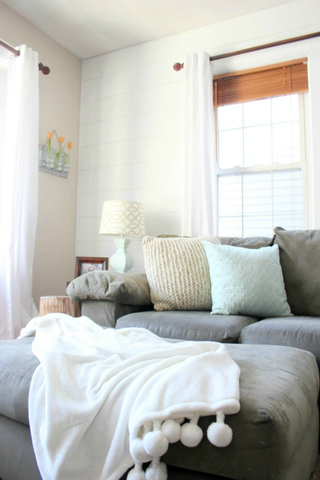 Love this neutral family room and the white shiplap wall kellyelko.com