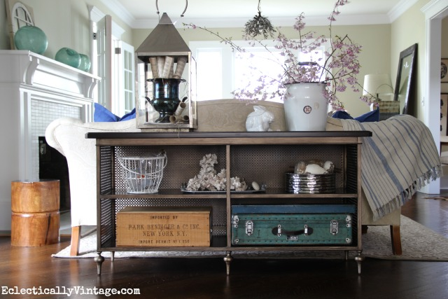 I love this Norton sofa table - it's vintage inspired and it has tons of storage space for showing off favorite things kellyelko.com