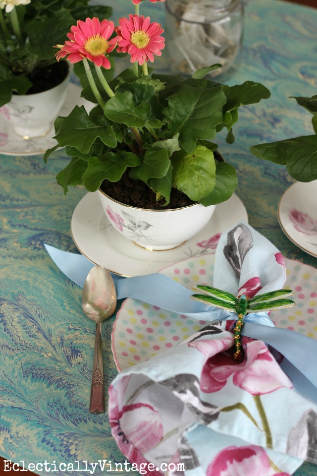 Spring table decorations - love the table runner and the vintage teacups filled with flowers kellyelko.com
