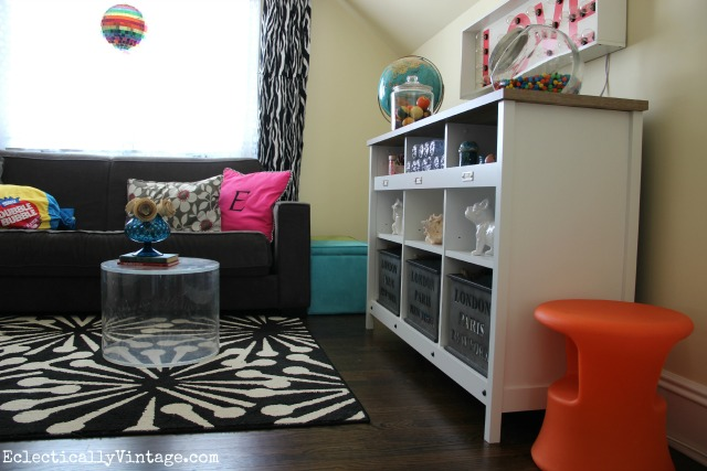 Love this colorful media room and the cubby storage kellyelko.com