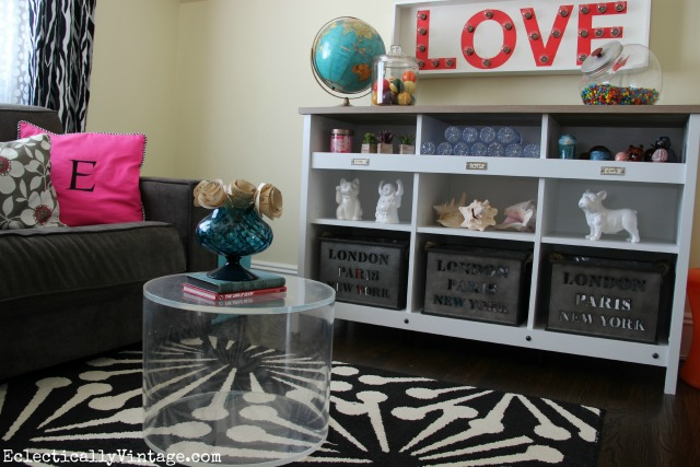 What a fun teen room - perfect for watching tv and hanging out and that storage cubby is great kellyelko.com
