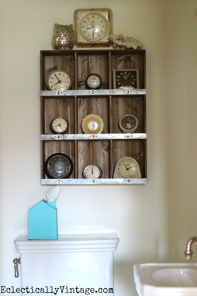 Love these rustic cubbies filled with this fun vintage clock collection kellyelko.com
