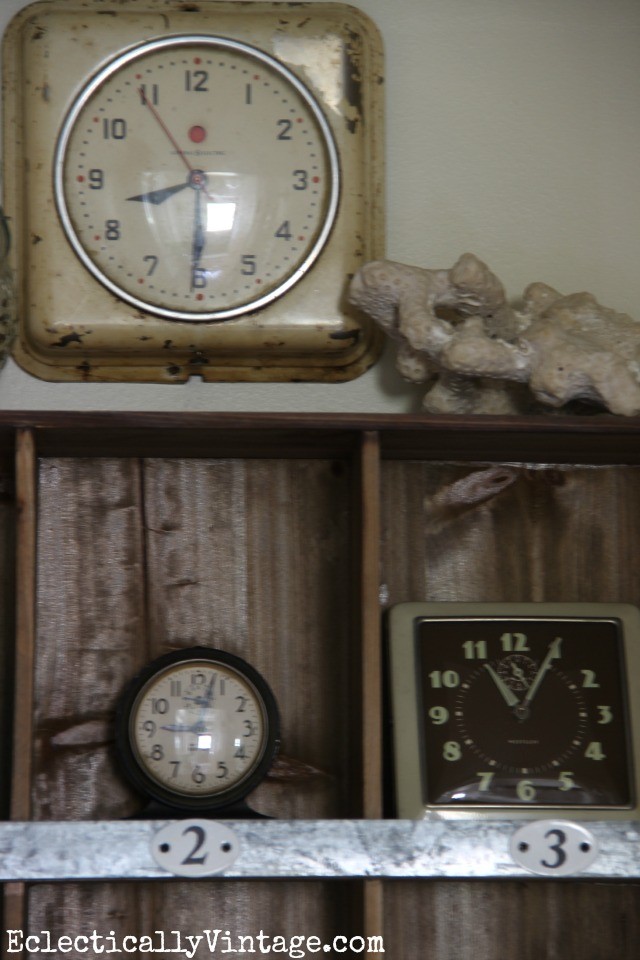 I love decorating with collections - these vintage clocks look great in these rustic cubbies kellyelko.com