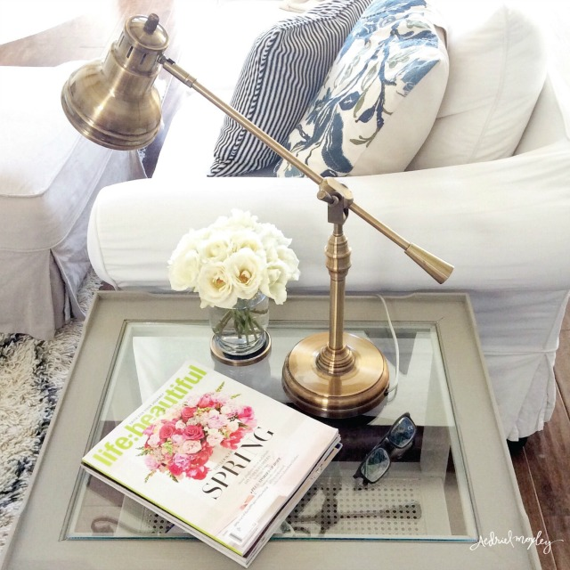 Brass pharmacy lamp is perfect on a living room end table kellyelko.com