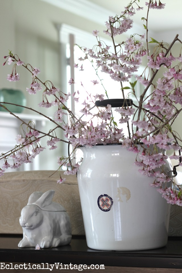 Fill a vintage bucket with fresh cut spring flowers for a beautiful display kellyelko.com
