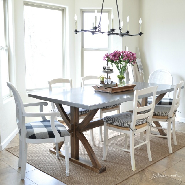 Love this wood and stainless steel dining table - the perfect mix of farmhouse and industrial kellyelko.com