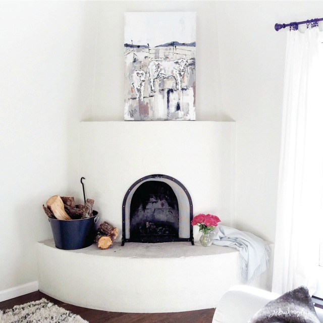 Love this white adobe fireplace kellyelko.com