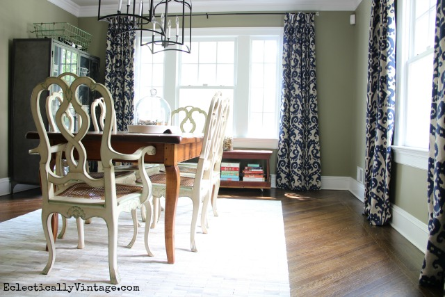 Love the drama that these curtains add to this eclectic dining room kellyelko.com