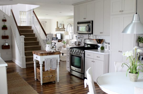 Country kitchen done on a tiny budget - love the gray kitchen cabinets and the butcher block island kellyelko.com