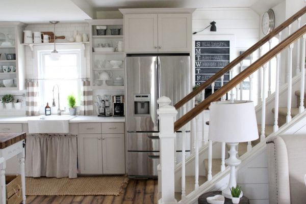 Country kitchen done on a tight budget - love the gray open cabinets and chalkboard command center kellyelko.com