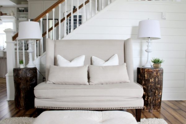 Love this high back settee and the DIY stump tables kellyelko.com