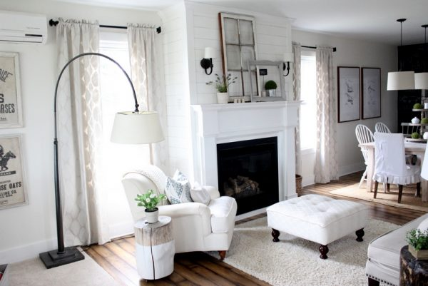 Love this cozy living room - the mantel is simple but beautiful and love the arched floor lamp kellyelko.com
