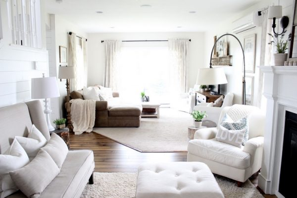 Love the layout of this long living room - separated by rugs and great furniture placement kellyelko.com