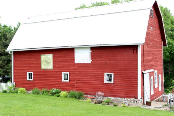 Gorgeous red barn is part of this three acre property with gorgeous home kellyelko.com