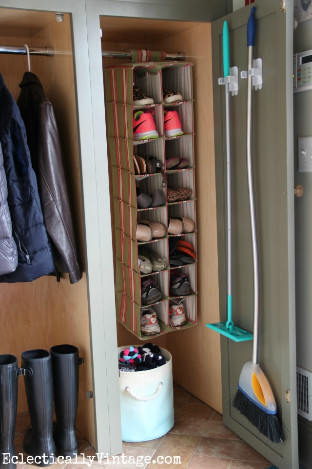 Love this organized mudroom - the shoe storage and the way she hung the brooms! kellyelko.com