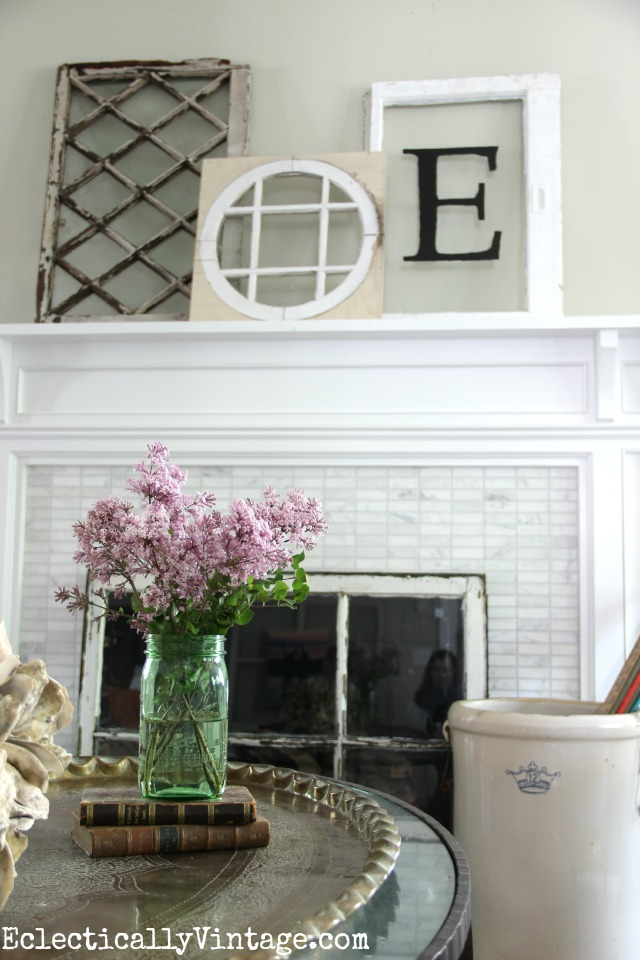 Love this antique window mantel and the window below used as a fireplace screen! kellyelko.com
