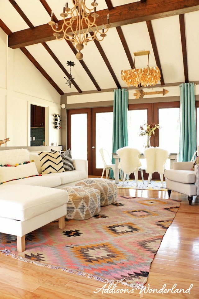 Love the high ceilings and rustic beams in this colorful home kellyelko.com