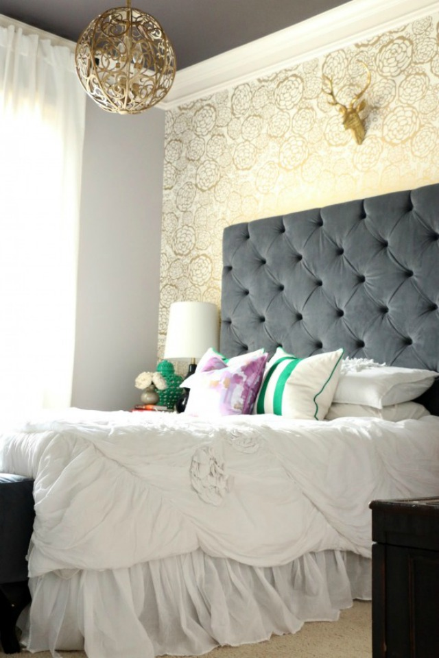 Glam gold bedroom with dramatic tufted headboard kellyelko.com