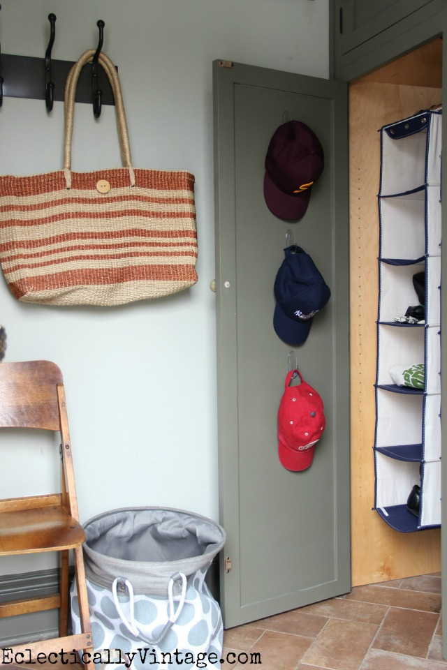 Make the most of unused behind the door space for hat organization kellyelko.com
