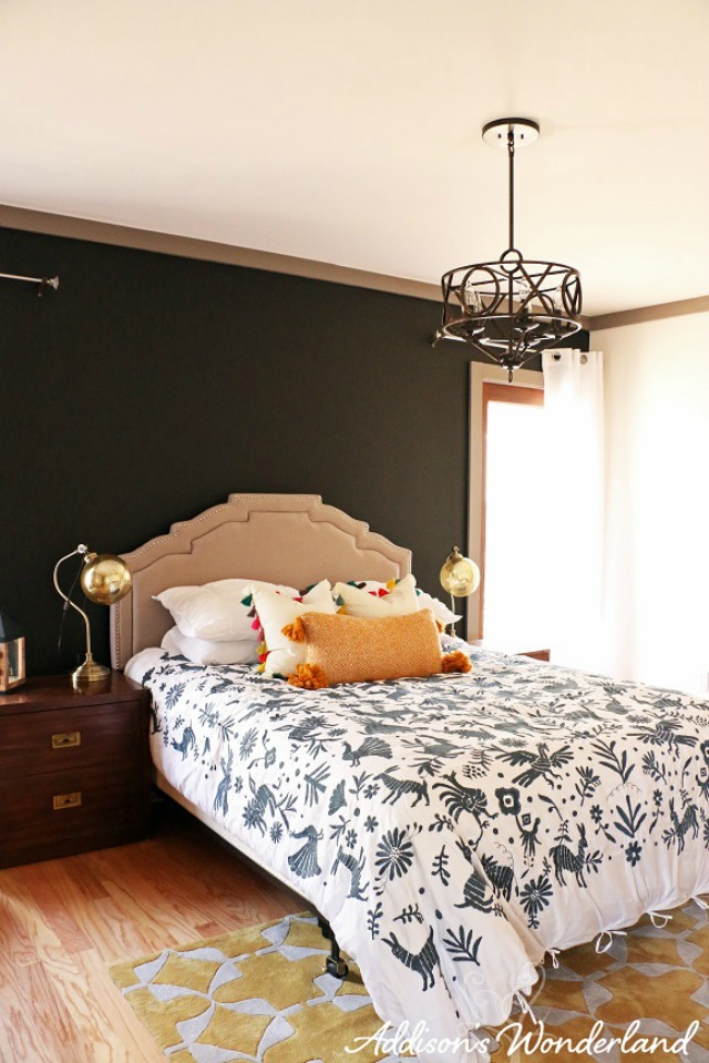 Love the dramatic black wall in this master bedroom kellyelko.com