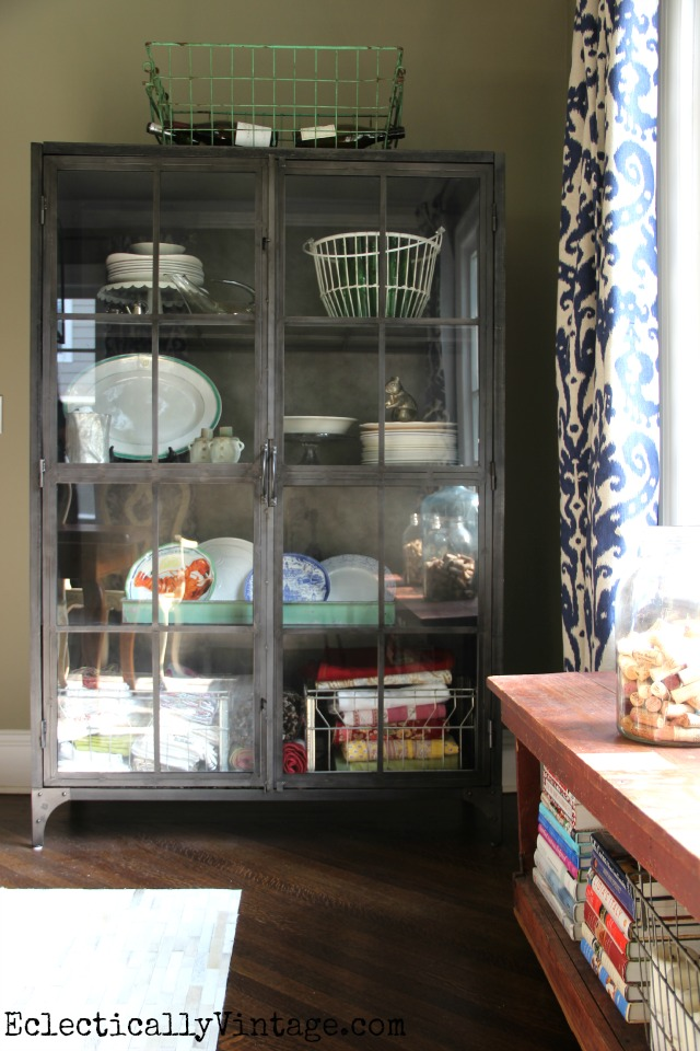Love this eclectic dining room and the mix of styles including this metal industrial cabinet kellyelko.com