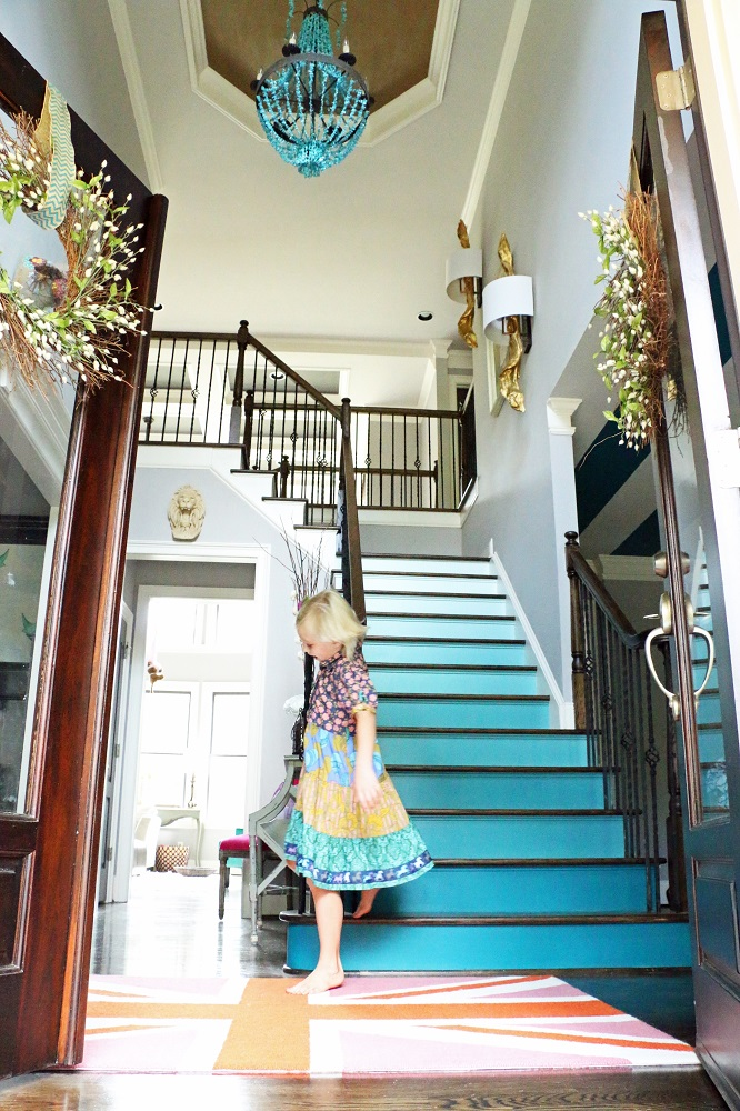 Love the colorful blue ombre stairs in this colorful home tour kellyelko.com