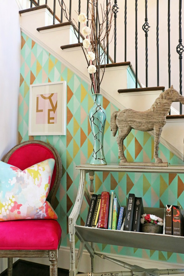 Create drama by stenciling a wall in a fun colorful and pattern kellyelko.com
