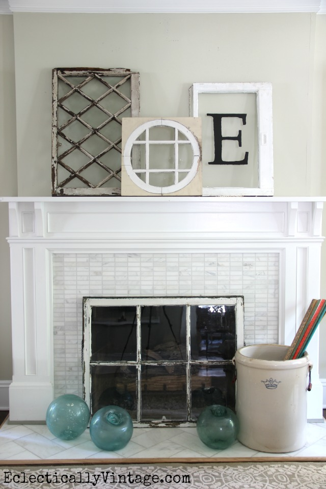 Love this cute summer mantel with a collection of antique windows and the window fireplace screen kellyelko.com