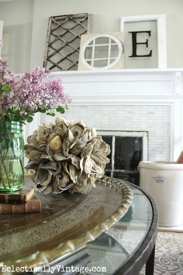 Love this antique window mantel and the accessories on the coffee table - look at that oyster shell ball! kellyelko.com