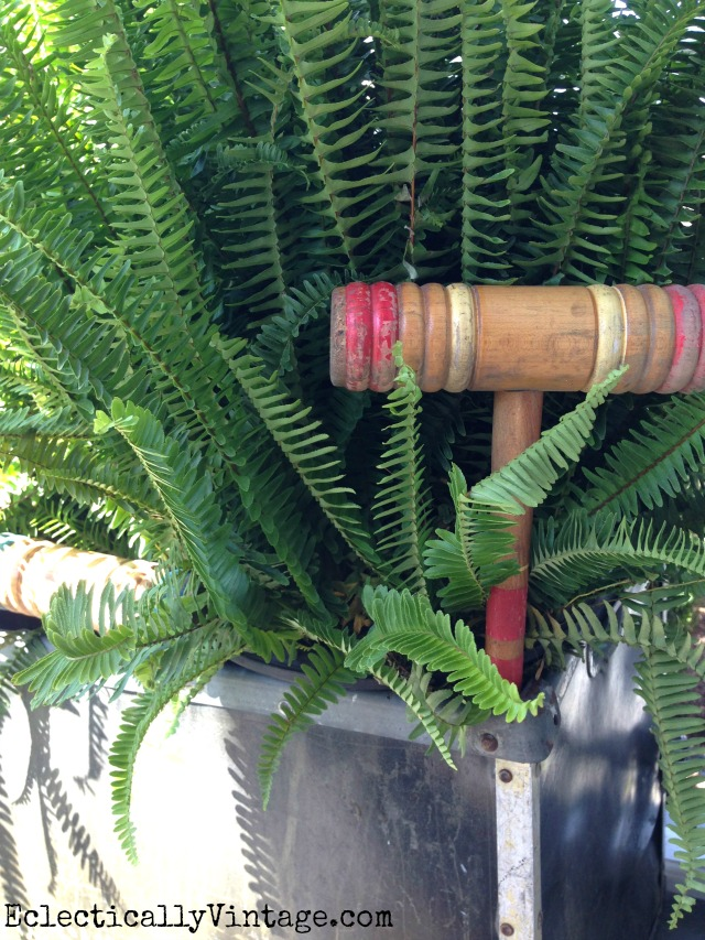 Tuck vintage finds like this croquet mallet into your plants - love this summer front porch kellyelko.com