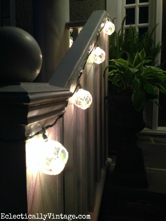 Love these buoy string lights on the front porch for summer kellyelko.com