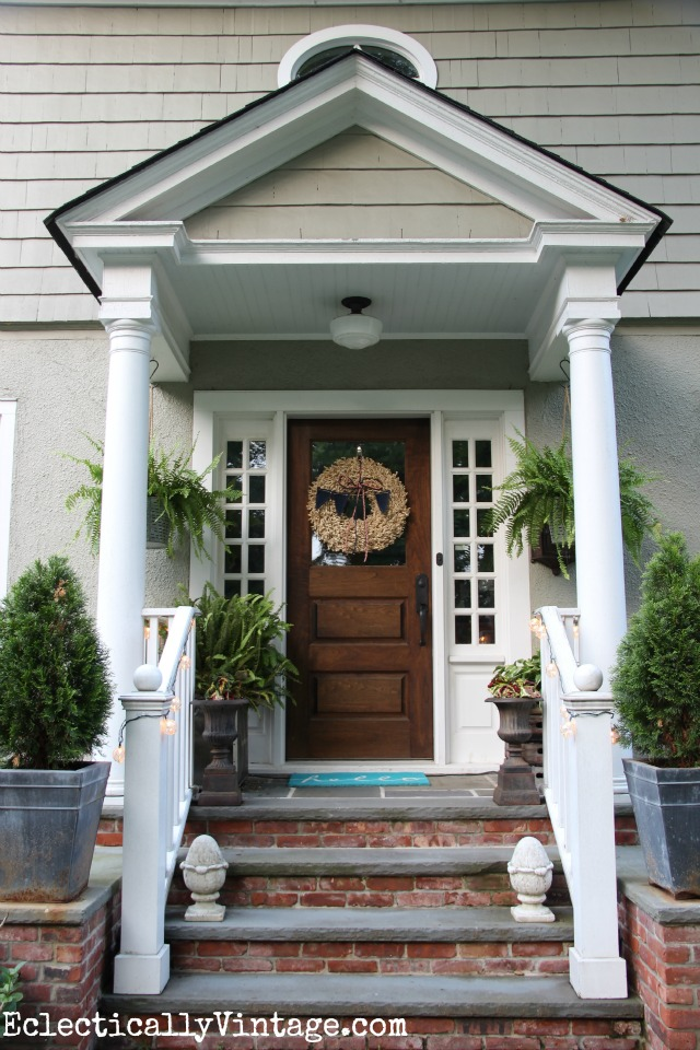 Love this summer front porch - the buoy lights are so cool and love that wreath kellyelko.com