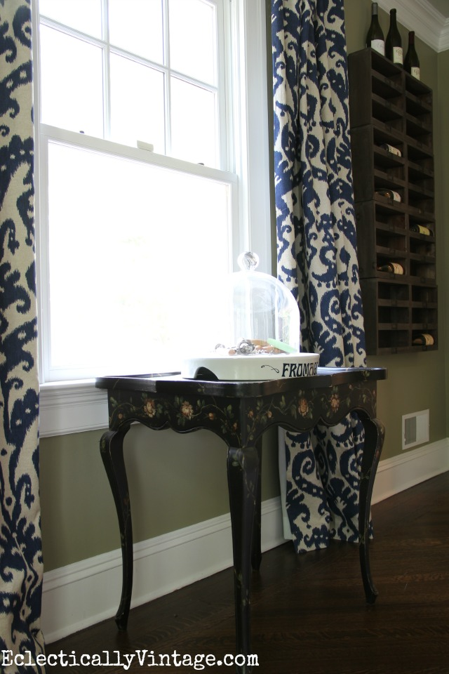 Love this black flower painted tea table in front of a window kellyelko.com