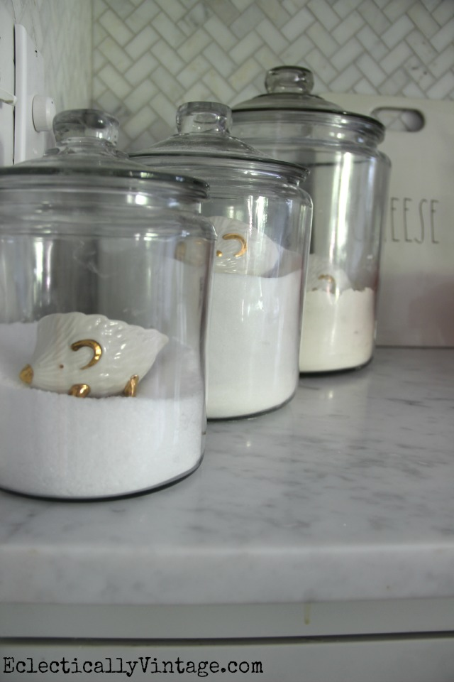 Love these huge clear glass canisters and the cute hedgehog measuring cups eclecticallyvintage.com