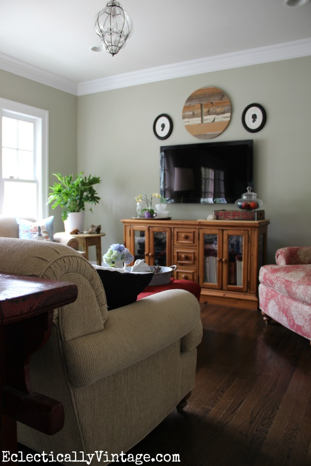 Love this cozy family room and the wood monogram over the tv kellyelko.com