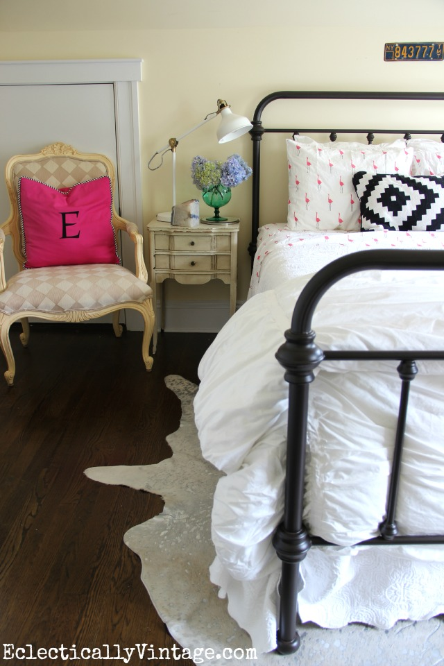 Love this cozy guest bedroom - the flamingo sheets, the Ikea finds (lamp and pillow), the silver cowhide kellyelko.com