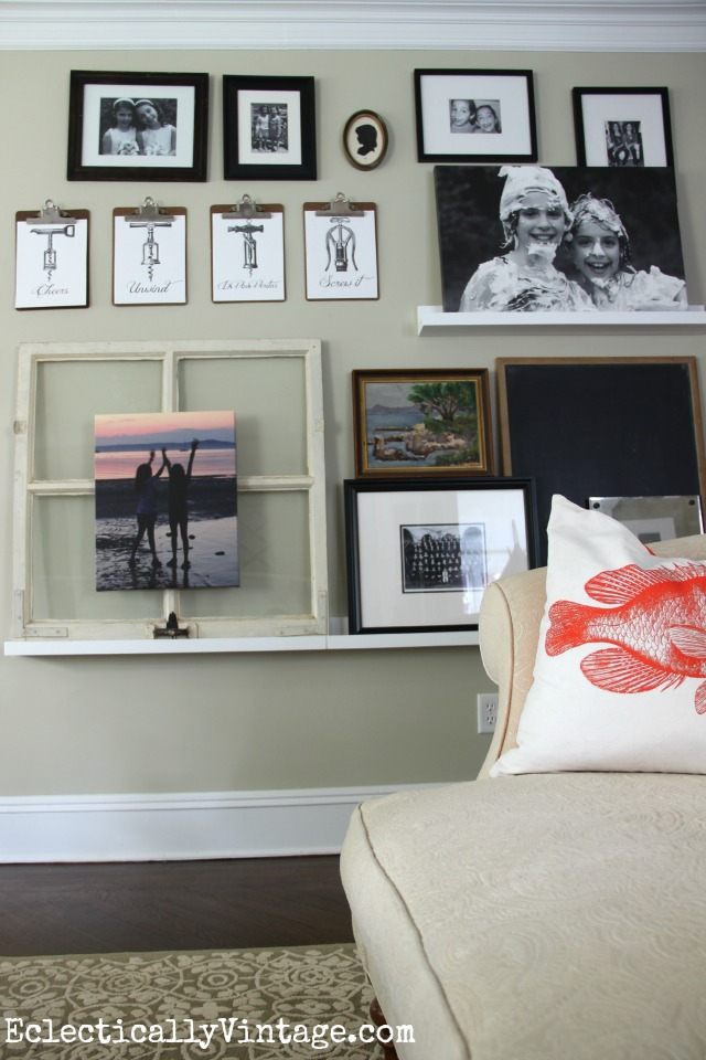 Love this eclectic picture ledge gallery wall kellyelko.com