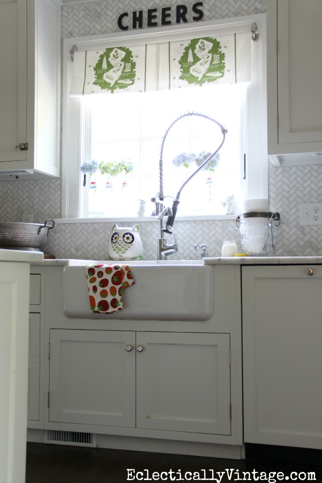Love this kitchen - the farmhouse sink, the dish towel window treatment ... eclecticallyvintage.com