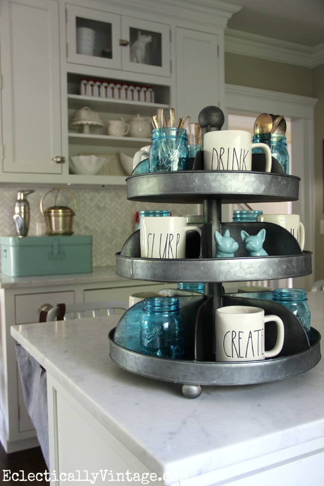 I LOVE this industrial hardware spinner as kitchen display in this gorgeous white kitchen kellyelko.com