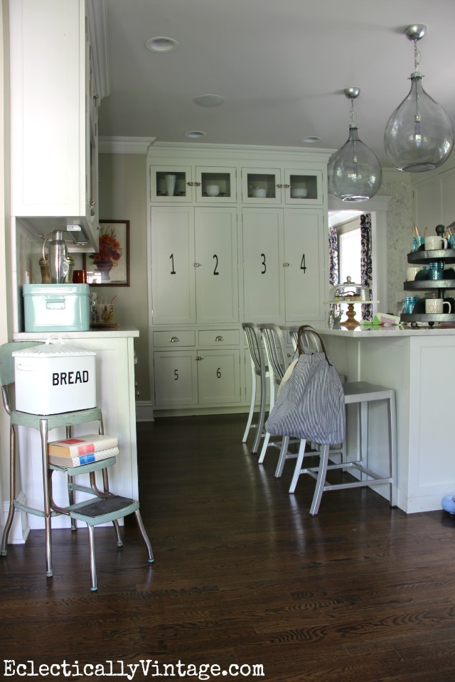 Love that huge numbered pantry wall in this gorgeous white kitchen eclecticallyvintage.com