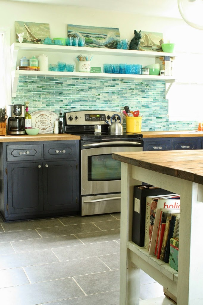 Beautiful kitchen with blue glass tile backsplash and open shelving kellyelko.com