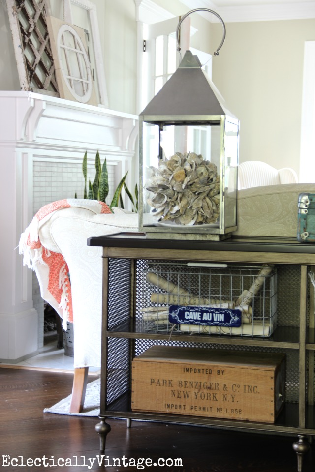 Love displaying things in lanterns - like this cool oyster shell orb eclecticallyvintage.com