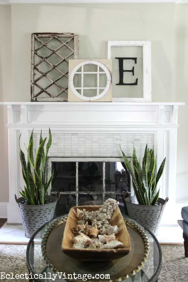 Love this mantel and the fun vintage finds including the old windows, vintage olive buckets and that huge old dough bowl kellyelko.com