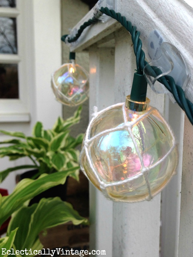 Love these buoy lights strung from the front porch - such a fun idea for summer kellyelko.com