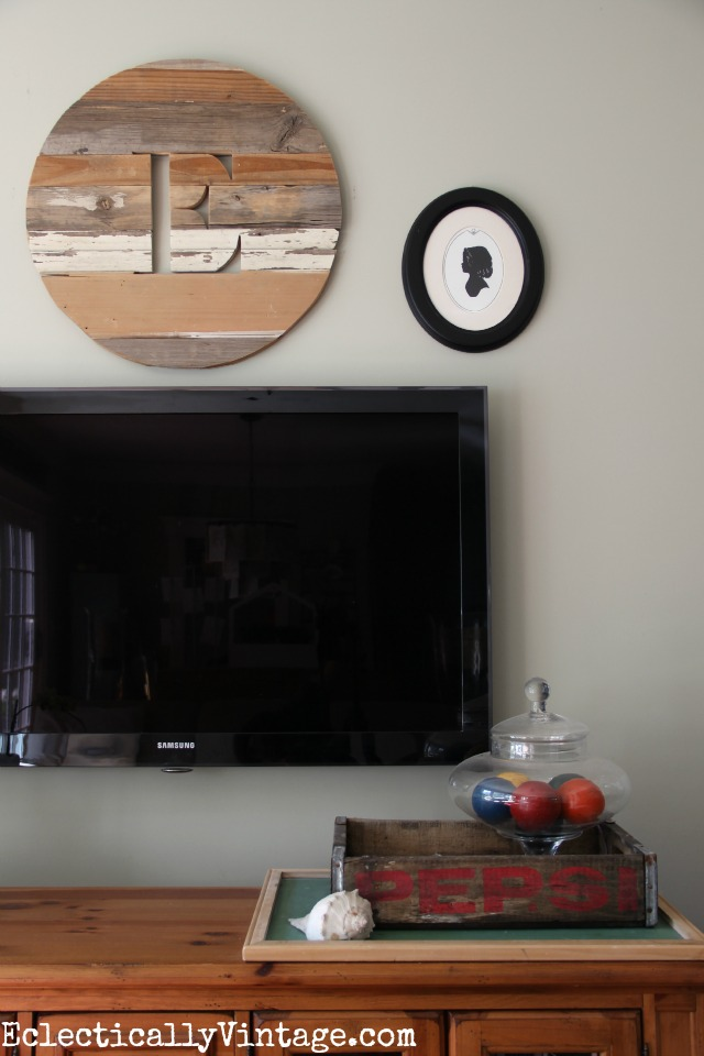 Love this wooden monogram over the tv kellyelko.com