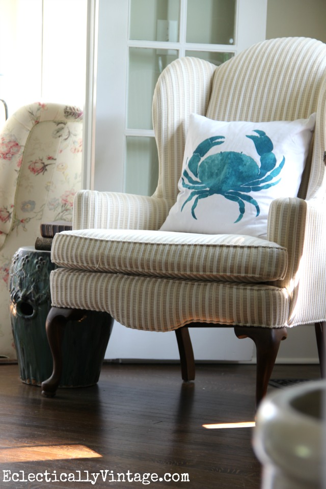 Cute little corner reading nook - love the blue crab pillow eclecticallyvintage.com